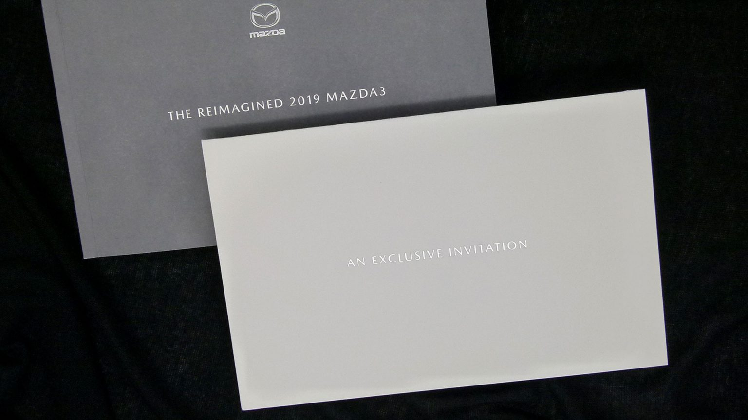 The soft-yet-chunky invitation featured a subtle Silver foil on the cover.